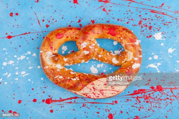 Traditional Austrian pretzel (brezel) painted in Austrian flag colors