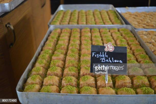 Traditional Baklava stuffed with pistachio is pictured at a bakery ahead of Eid alFitr in Ankara Turkey on June 23 2017