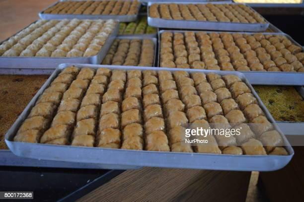 Traditional Baklava stuffed with walnut is pictured at a bakery ahead of Eid alFitr in Ankara Turkey on June 23 2017