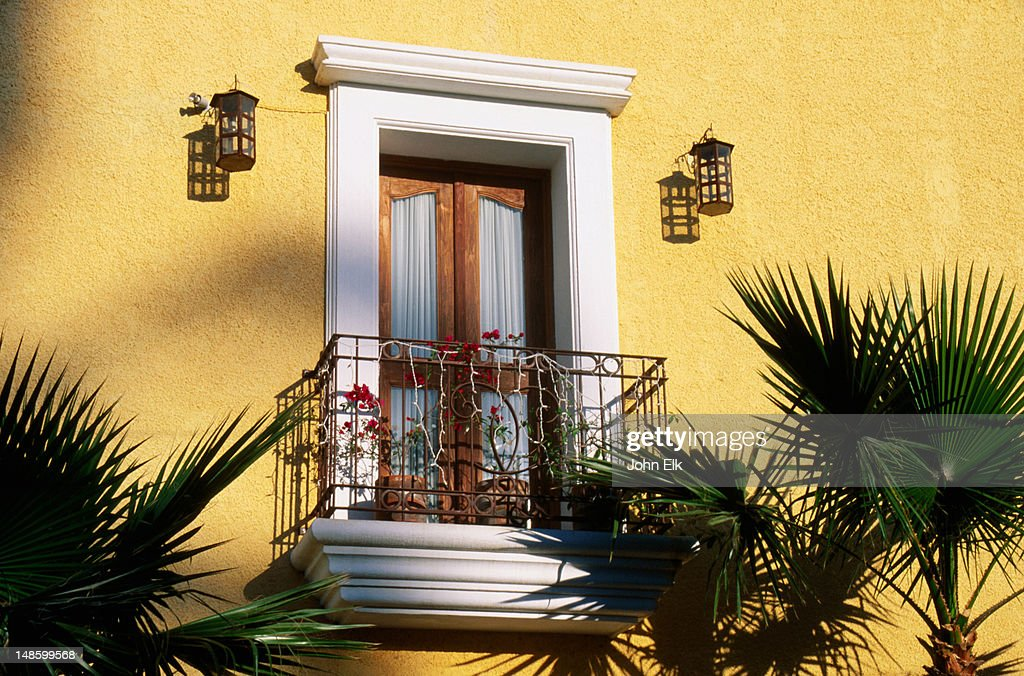 Traditional balcony framed by palm trees stock photo for Traditional balconies