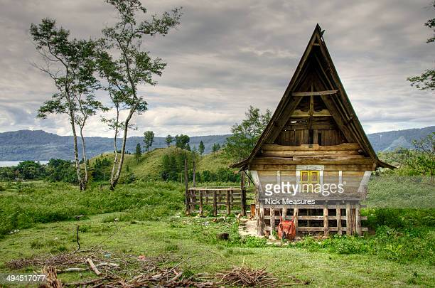 CONTENT] Traditional Batak house situated in the hills around Lake Toba North Sumatra Indonesia