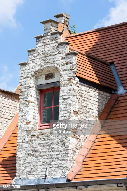 Traditional Belgian architecture crowstepped gable and terracotta roof tiles in Bruges Brugge Belgium