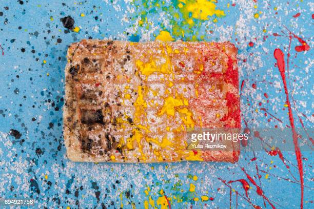 Traditional Belgian waffle painted in Belgian flag colors