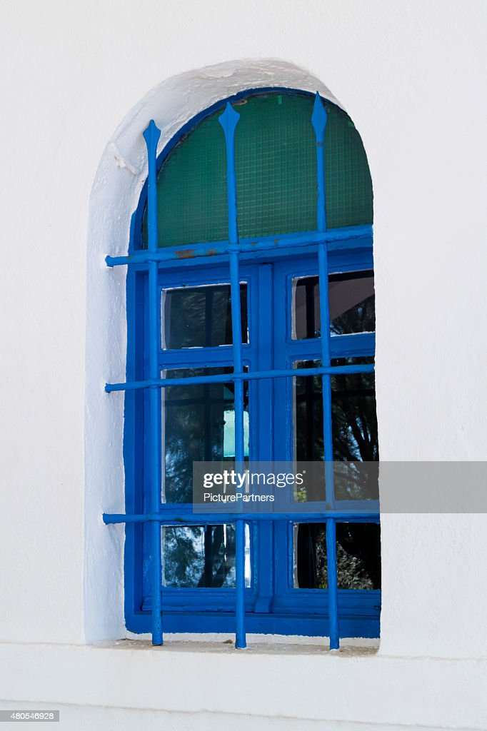 Traditional blue painted greek window : Stock Photo