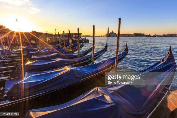 Traditional boat during sunrise in Venice, Italy
