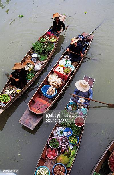 Traditional boats with fruit and vegetables floating market in Bangkok Thailand