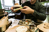 man eating Traditional British Dishes dinnertime