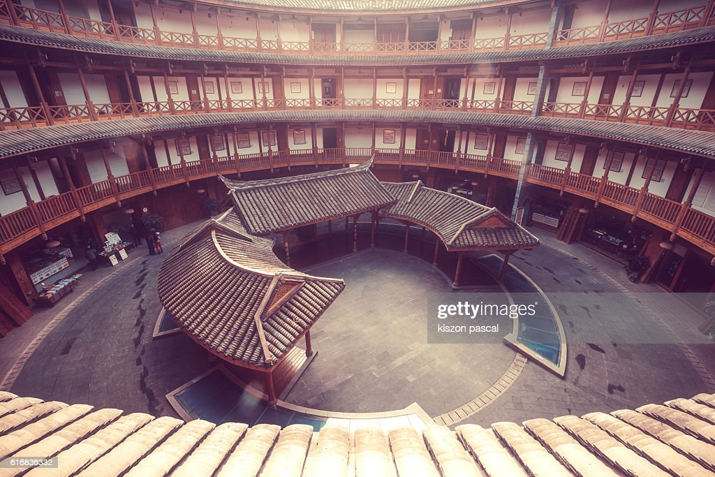 Traditional Chinese round building in wood in day : Stock Photo