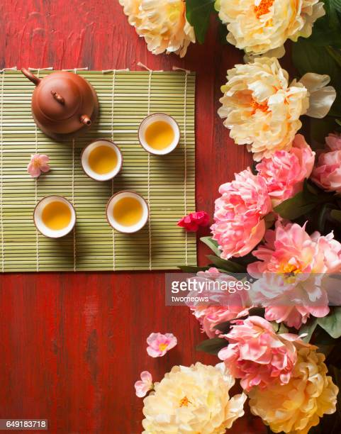 Traditional Chinese tea and peony blossoms.