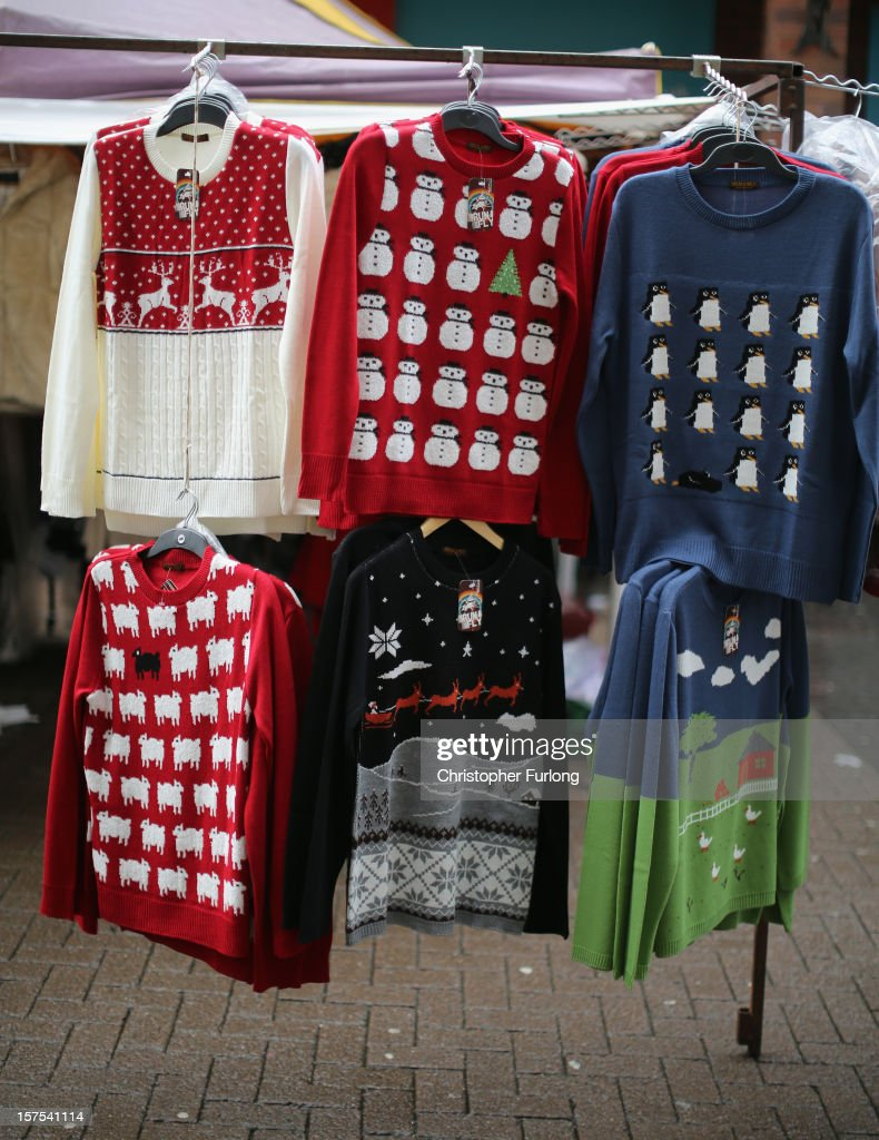 Traditional Christmas jumpers hang on a rail to entice buyers on December 4, 2012 in Rotherham, United Kingdom. Retailers across Britain are struggling as people wait for bigger discounts before spending for the Christmas period. The British Retail Consortium (BRC) said that it's members were in a 'state of nervousness' in the last weeks of the festive period.
