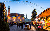 Traditional Christmas market in Tallinn old town. HDR image. Long time exposure with motion blur.