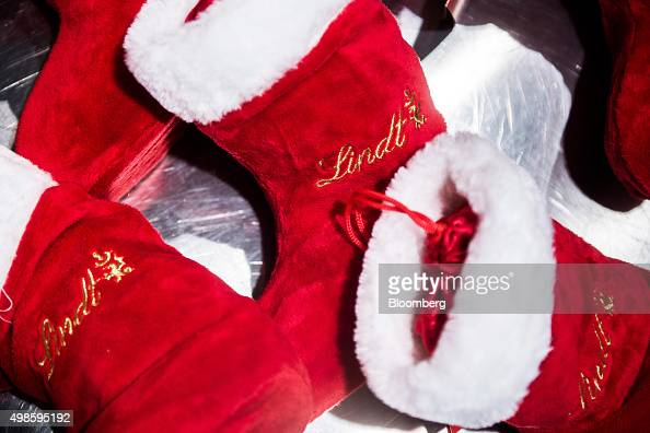 Traditional Christmas stockings branded with the Lindt Spruengli AG logo sit on display at a duty free store inside Zurich Airport in Zurich...