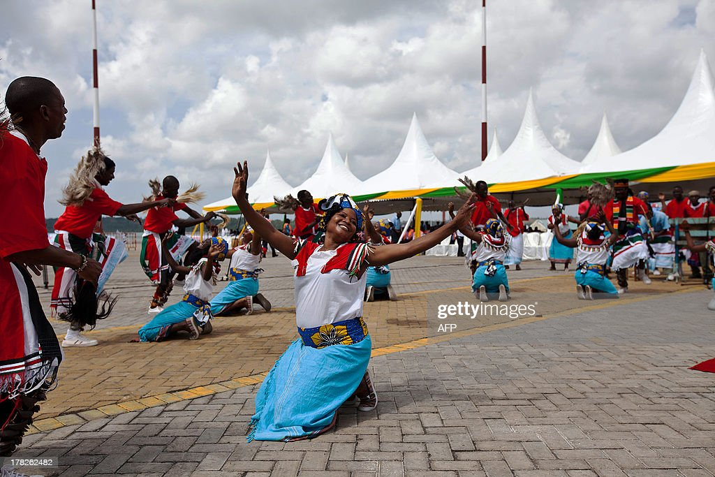 Traditional coastal dancers perform at the inauguration of Berth No.19 at the Mombasa Port on August 28, 2013. President of Kenya Uhuru Kenyatta together with his counterpart of Uganda Yoweri Museveni and Rwanda Paul Kagame inaugurate the commisioning of Berth No. 19 at the Mombasa Port. It is the deepest berth in East Africa with a depth of 13.5 metres. It will help handle cargo capacity ships boosting the economy throughout East Africa. AFP PHOTO/IVAN LIEMAN