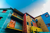 Orange, red, blue, and yellow traditional South America houses