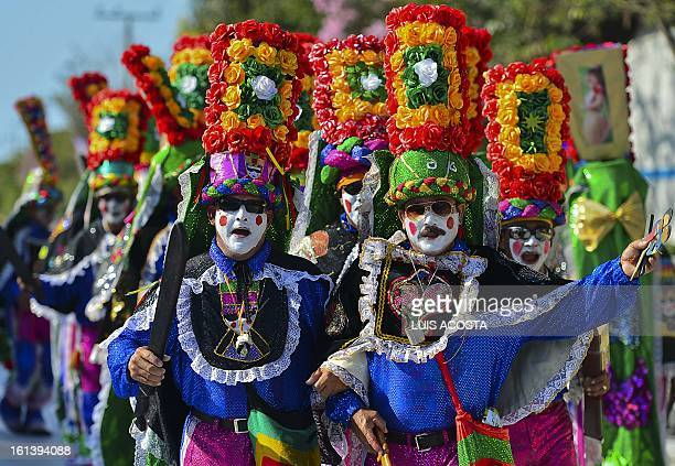 Traditional 'Congo' dancers take part in the second day of carnival parade in Barranquilla Colombia on February 10 2013 Barranquilla's Carnival a...