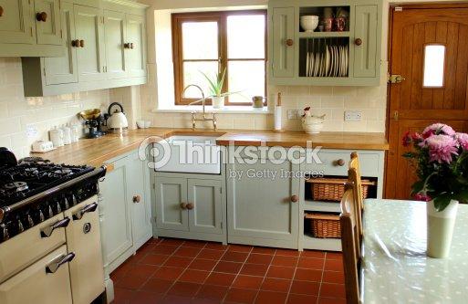 Traditional country kitchen, gas range cooker, Belfast sink, wooden  worktops : Stock Photo