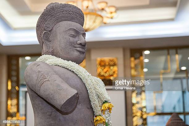 A traditional crown of flowers sits on the neck of the Duryodhana statue during a handover ceremony at the Council of Ministers on June 3 2014 in...