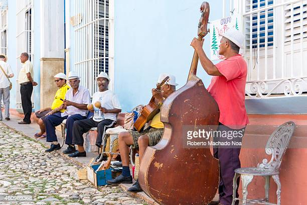 Traditional Cuban music street musicians playing in Trinidad streets as a way of entertainment to tourists and visitors