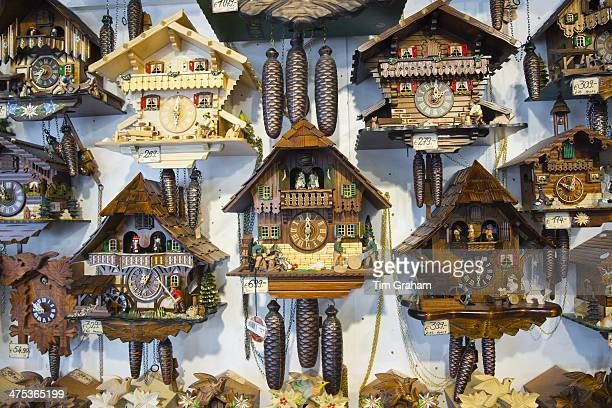 Traditional cuckoo clocks on sale in Geschenkehaus shop in the town of Seefeld in the Tyrol Austria