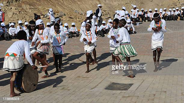 A traditional dance group performs in Mvezo the birth place of former South African President Nelson Mandela on July 18 2013 to celebrate Nelson...
