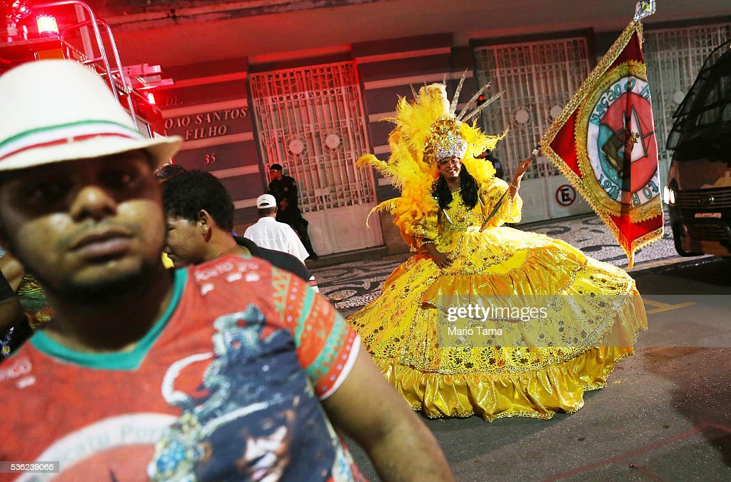 Traditional dancers gather at the conclusion point of the day's Olympic torch relay on May 31, 2016 in Recife, Brazil. The Olympic flame will pass through 329 cities from all states from the north to the south of Brazil, before arriving in Rio de Janeiro on August 5, for the lighting of the cauldron for the Rio 2016 Olympic Games. The games will be held amidst an economic and political crisis in the country.