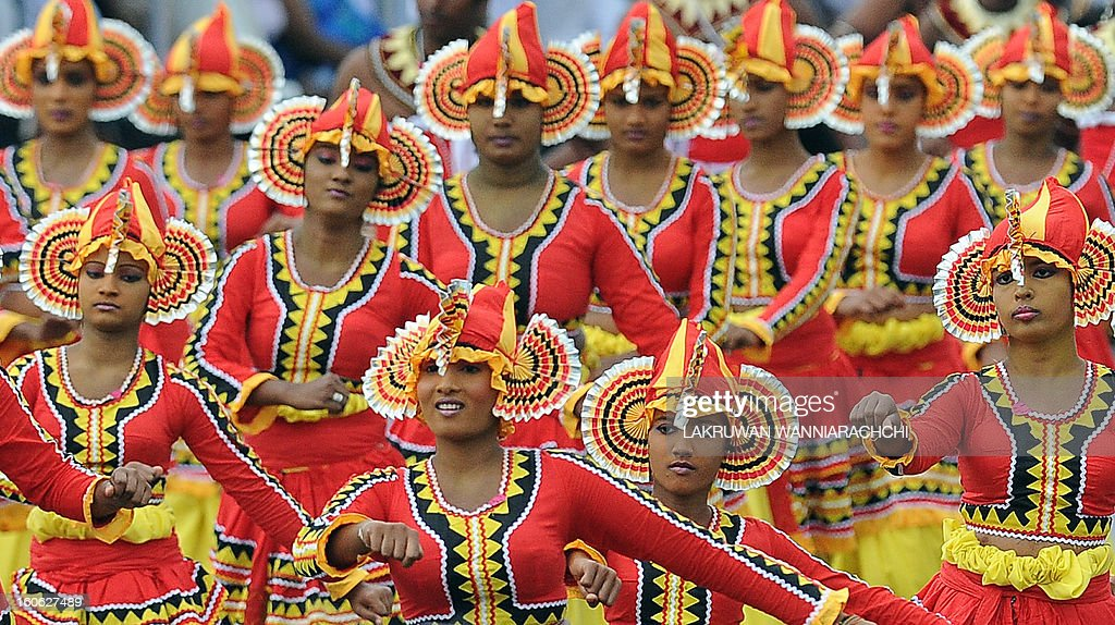 Traditional dancers participate in a parade marking the country's 65th Independence Day in the northeastern town of Trincomalee on February 4, 2013. Sri Lanka marked its freedom anniversary with a thinly veiled denunciation of Western moves to pass a new resolution against the island at the UN Human Rights Council.