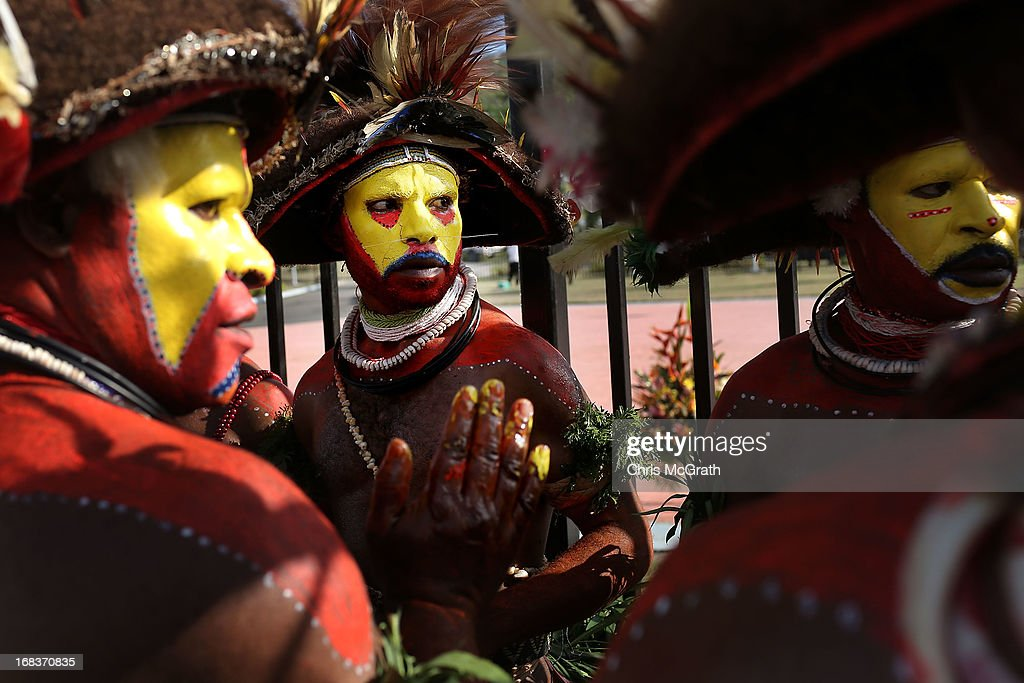 Traditional dancers perform ahead of the arrival of Australian Prime Minister <a gi-track='captionPersonalityLinkClicked' href=/galleries/search?phrase=Julia+Gillard&family=editorial&specificpeople=787281 ng-click='$event.stopPropagation()'>Julia Gillard</a> at Jackson International Airport on May 9, 2013 in Port Moresby, Papua New Guinea. The trip is the first official visit for Prime Minister <a gi-track='captionPersonalityLinkClicked' href=/galleries/search?phrase=Julia+Gillard&family=editorial&specificpeople=787281 ng-click='$event.stopPropagation()'>Julia Gillard</a> to the Pacific Island Nation and the first visit since former prime minster Kevin Rudd visited in 2007. The three-day visit will include trips to a local market and primary school as well as tours of the Exxon Mobil Liquefied Natural Gas plant and the Bomana War Cemetery.