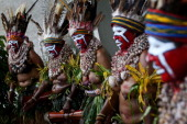 Traditional dancers perform ahead of the arrival of Australian Prime Minister Julia Gillard and Papua New Guinea Prime Minister Peter O'Neill at...