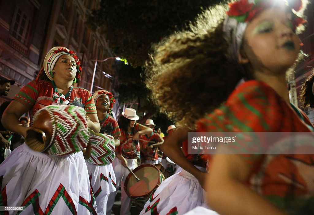 Traditional dancers perform at the conclusion point of the day's Olympic torch relay on May 31, 2016 in Recife, Brazil. The Olympic flame will pass through 329 cities from all states from the north to the south of Brazil, before arriving in Rio de Janeiro on August 5, for the lighting of the cauldron for the Rio 2016 Olympic Games. The games will be held amidst an economic and political crisis in the country.