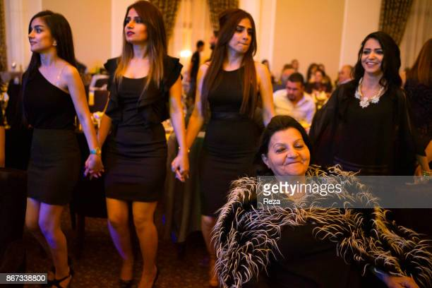 Traditional dances and contemporary outfits of the young Kurdish women from the Assyrian community during a gathering to celebrate Easter in the big...