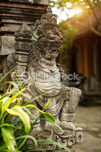 Traditional demon guard statue carved in stone on Bali : Stock Photo