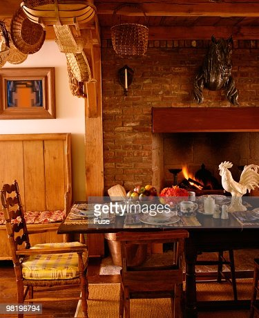Traditional Dining Room With Brick Fireplace Stock Photo