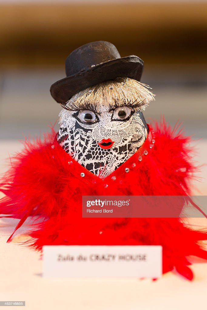 A traditional Doll 'Okiagari Koboshi' decorated by dancer Zula of the Crazy Horse Mainoumi is displayed during the 'Solidarite Fukushima' exhibition in tribute to the victims of Fukushima on December 5, 2013 in Paris, France.
