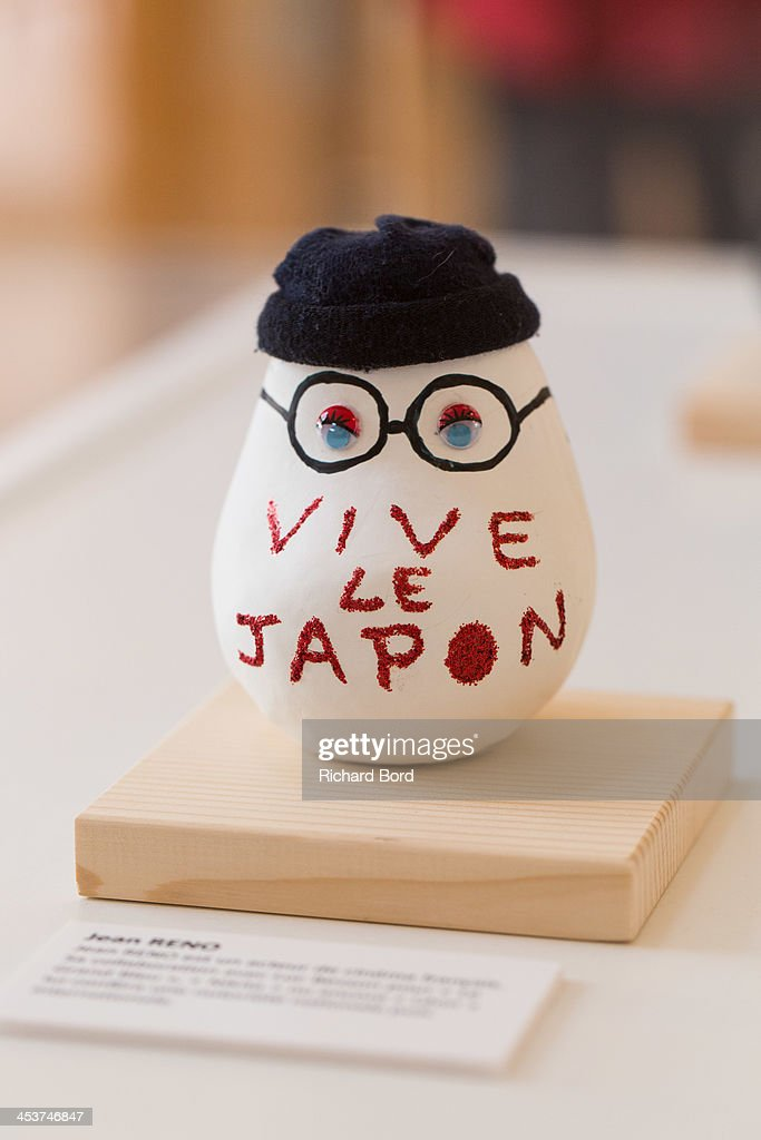 A traditional Doll 'Okiagari Koboshi' decorated by Jean Reno is displayed during the 'Solidarite Fukushima' exhibition in tribute to the victims of Fukushima on December 5, 2013 in Paris, France.