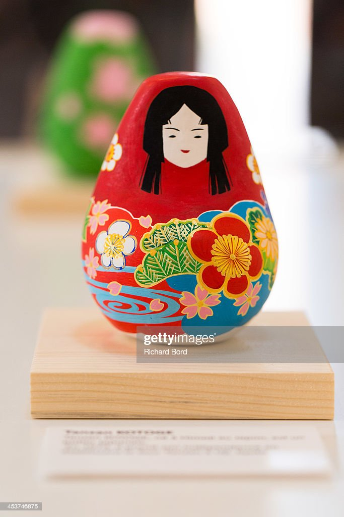 A traditional Doll 'Okiagari Koboshi' decorated by potter Tanzan Kotoge is displayed during the 'Solidarite Fukushima' exhibition in tribute to the victims of Fukushima on December 5, 2013 in Paris, France.