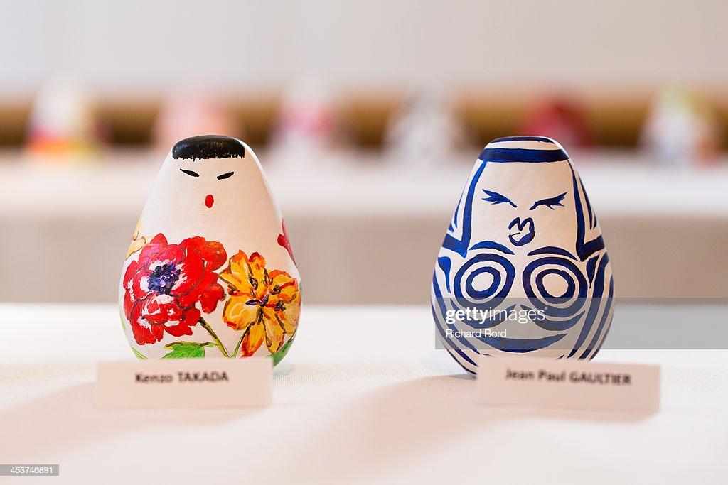 Traditional Dolls 'Okiagari Koboshi' decorated by Kenzo Takada (L) and Jean-Paul Gaultier (R) are displayed during the 'Solidarite Fukushima' exhibition in tribute to the victims of Fukushima on December 5, 2013 in Paris, France.
