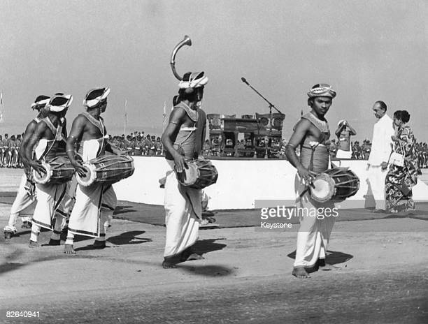 Traditional drummers perform as Sri Lanka's first president Junius Richard Jayewardene arrives for the oathtaking ceremony Columbo Sri Lanka 1978