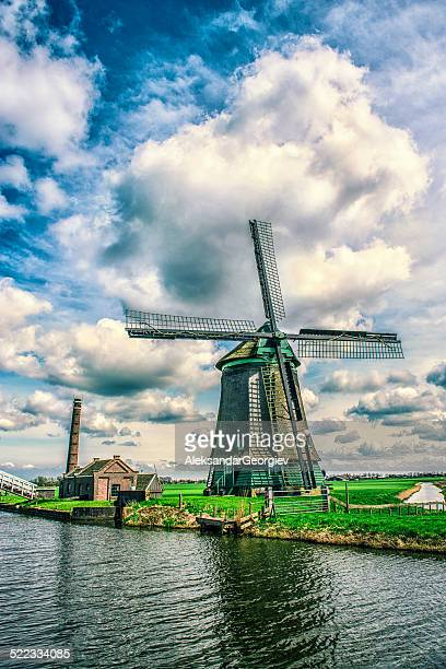 Traditional Dutch Windmill on a Typical Canal in Netherlands
