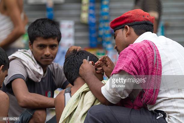 Traditional ear cleaner, New Delhi, India