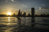 A traditional Egyptian boat known as a 'Faluka' sails on the Nile River during sunset in the capital Cairo on September 22 2015 AFP PHOTO / KHALED...