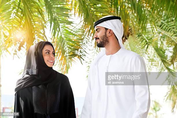 Traditional Emirati young couple enjoying life outdoor.