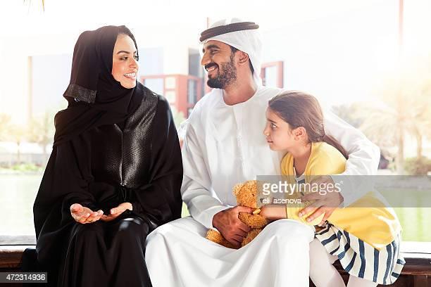 Traditional Emirati young family enjoying weekend