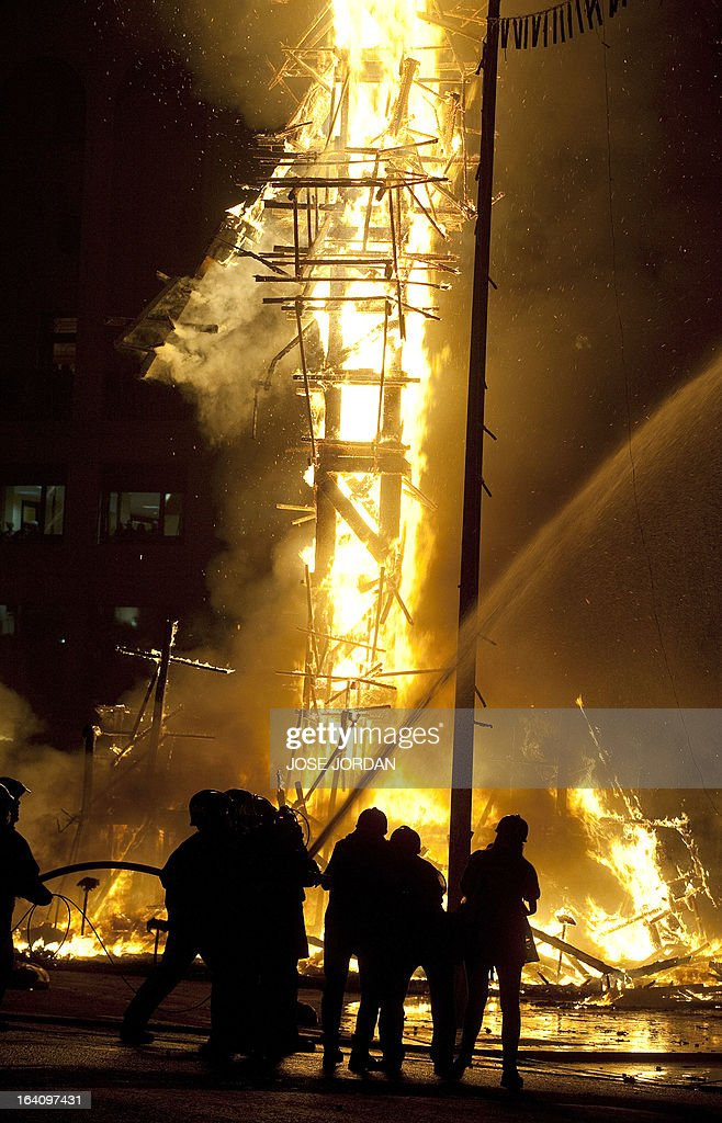 A traditional 'Falla' sculpture burns down on the last day of the 'Fallas' festival in Valencia March 19,2013. The 'Fallas', the name for structures made of cardboard, wood or cork, are exhibited in the streets of Valencia for the duration of the festival and are set on fire on the last day of the event.