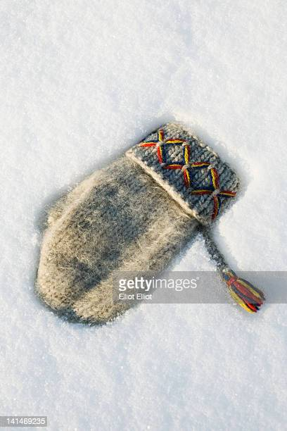 Traditional fingerless glove on snow