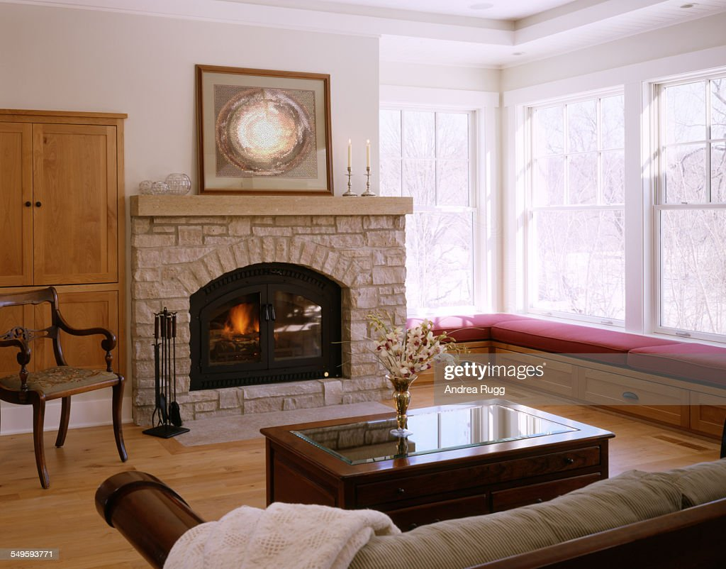 traditional fireplace next to window seat stock photo getty images