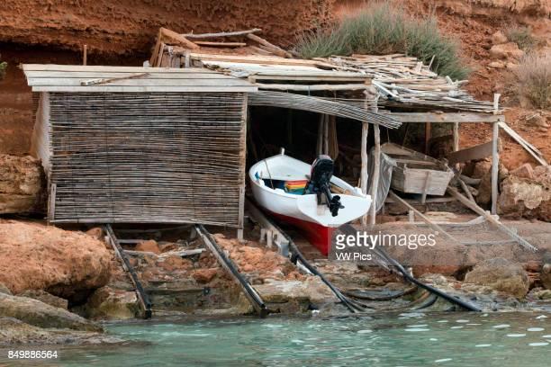 Traditional fishing boat in summer day LlaÙt boats Cala Sahona Formentera Balearics Islands Spain