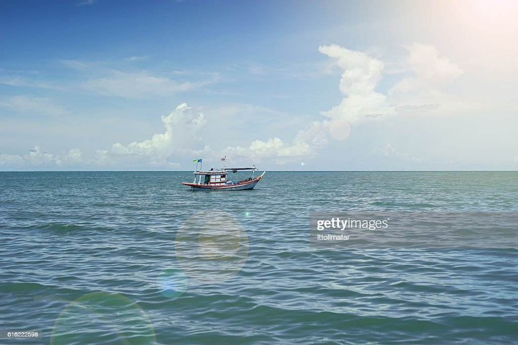 traditional fishing boat laying alone on the sea : Photo