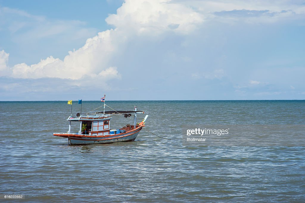 traditional fishing boat laying alone on the sea,selective : Stock Photo