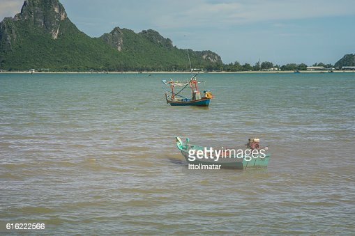 traditional fishing boat laying on a wave : Stock-Foto