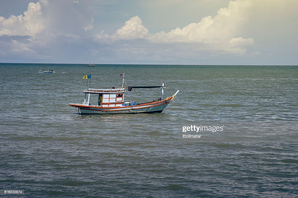 traditional fishing boat laying on the sea : Stock-Foto